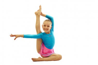 young  girl doing gymnastics exercises