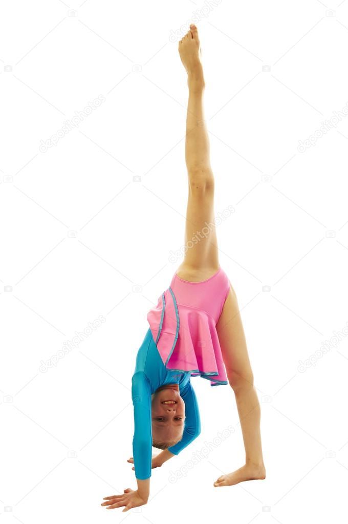 b5071a6c9 young girl doing gymnastics exercises — Stock Photo © CarMan  86119476