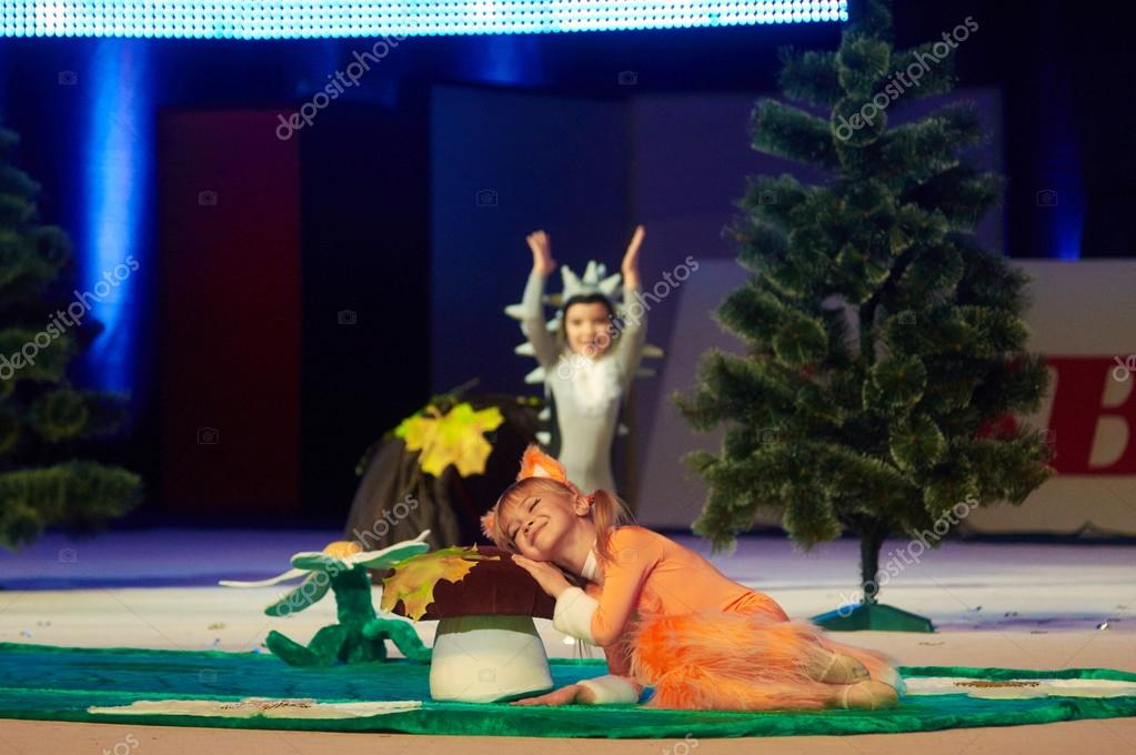 MINSK, BELARUS DECEMBER 05: Chetvernya Mariya, Parhomenko Anastasiya from 'trade union sports School' participate with 'Hedgehog and the Fox'  in 'Baby Cup - BSB Bank' children's competitions in gymna