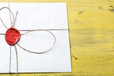 White envelope with wax seal