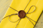 Fotografie Yellow letter with wax seal