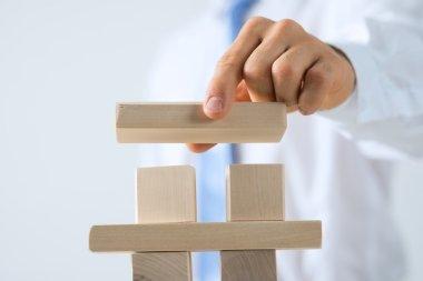 businessman building tower