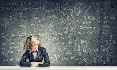 woman over education blackboard