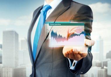 businessman presenting virtual graphs and charts