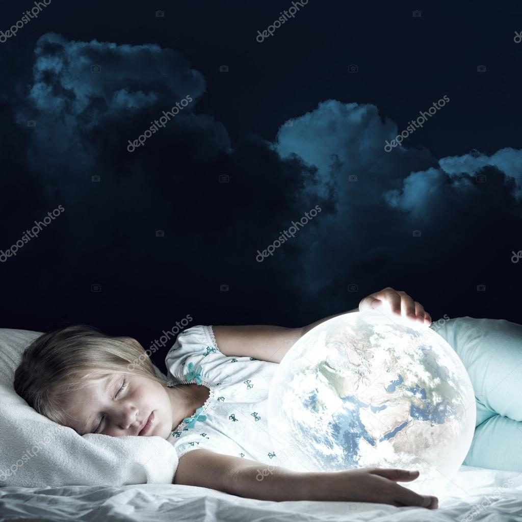girl in bed and looking at Earth planet