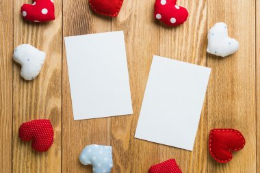 Love hearts and sheets of blank paper