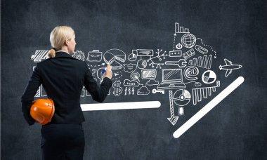 Businesswoman draws various business infographics