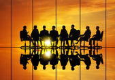Fotografie Business meeting against sunset