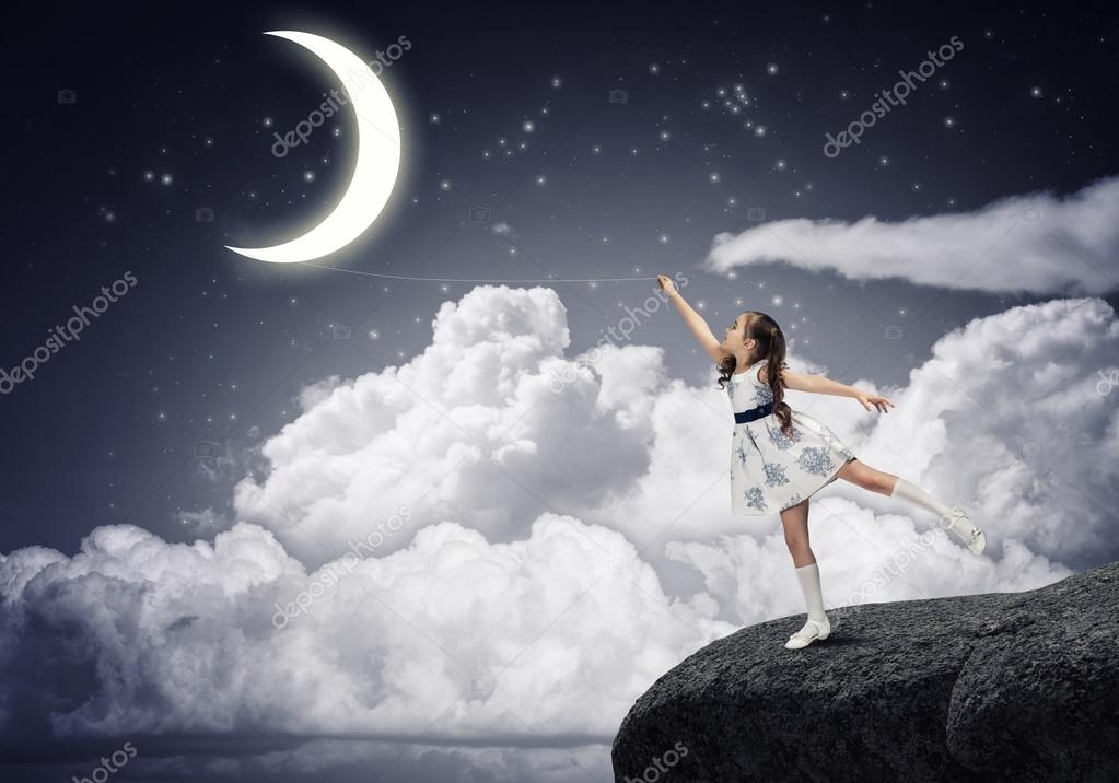 Girl Catching The Moon Stock Photo