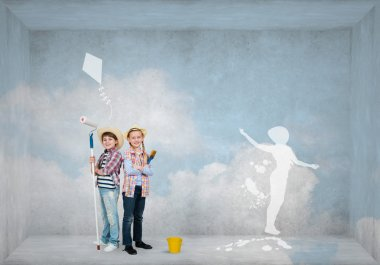 boy and girl painting wall