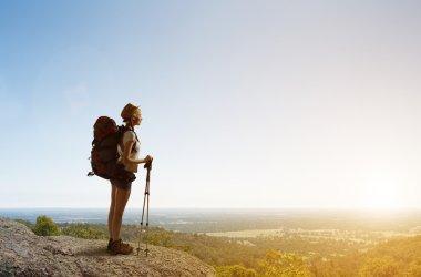 woman hiker walking in mountain
