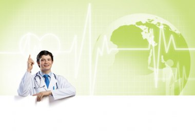 Young handsome doctor holding white blank banner stock vector