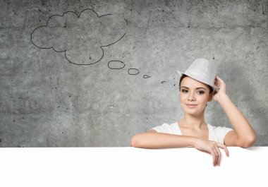 Portrait of young thoughtful woman in hat with blank white banner stock vector