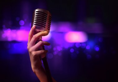 female hand with microphone