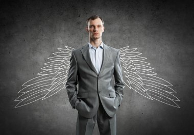 Businessman with chalk drawn wings