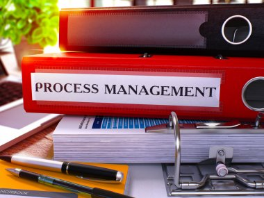 Process Management on Red Office Folder. Toned Image.