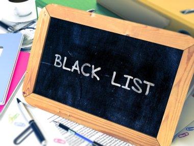 Black List Concept Hand Drawn on Chalkboard.