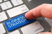 Hand Touching Business Strategy Button.