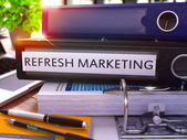 Refresh Marketing on Black Ring Binder. Blurred, Toned Image.