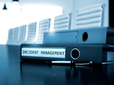 Incident Management on Office Folder. Toned Image.