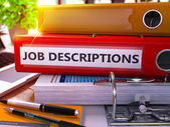 Fotografie Red Office Folder with Inscription Job Descriptions.