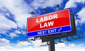 Fotografie Labor Law on Red Billboard.