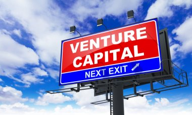 Venture Capital Inscription on Red Billboard.