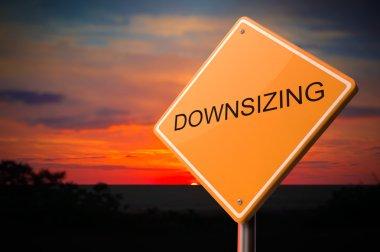Downsizing on Warning Road Sign.