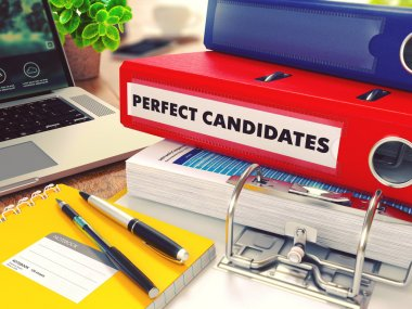 Perfect Candidates on Red Office Folder. Toned Image.