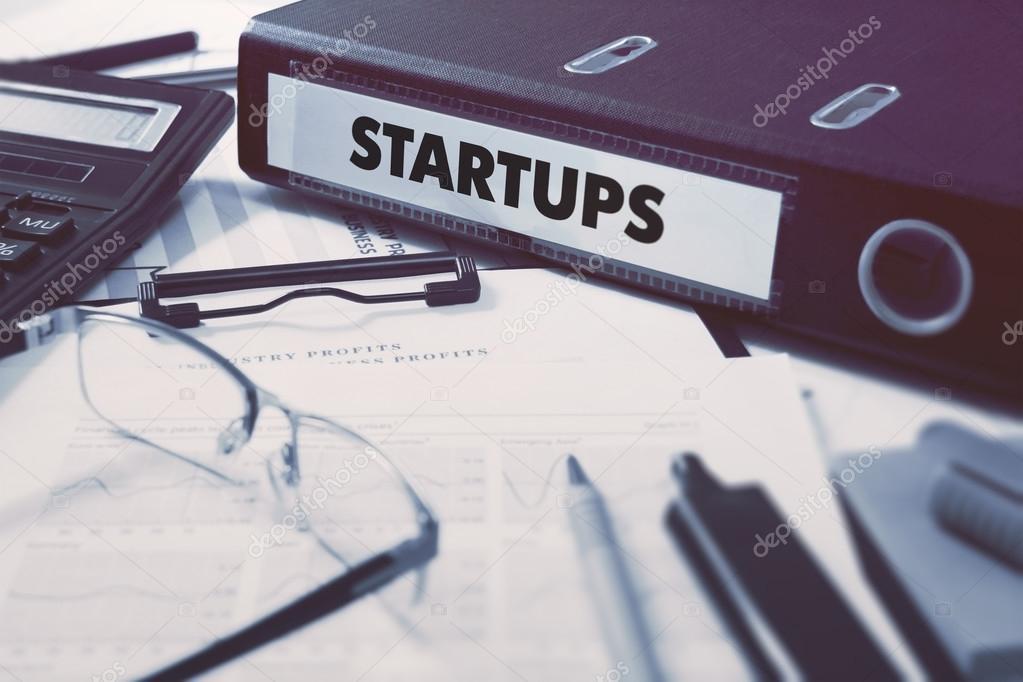Office folder with inscription Startups.