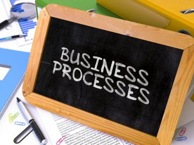 Hand Drawn Business Processes Concept on Small Chalkboard.
