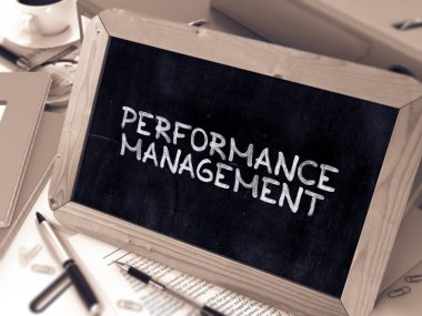 Performance Management Concept Hand Drawn on Chalkboard.