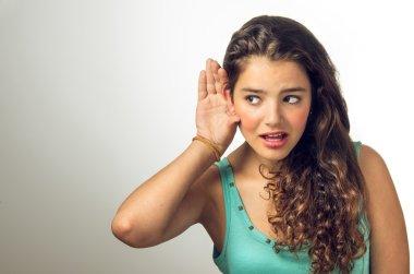 Girl secretly hearing something
