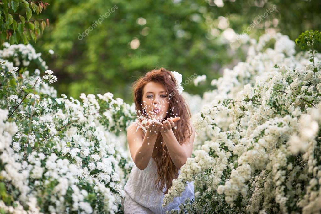 Beautiful Happy Girl In Blossom Garden On A Spring Day