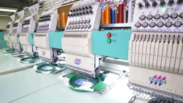 Embroidery machines make Akbars hockey team logos in shop