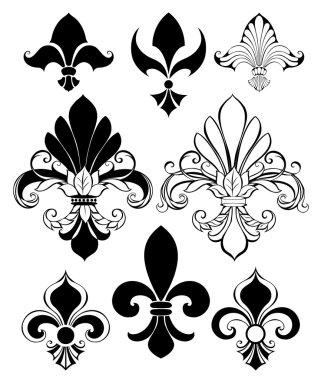Set of artistically painted, isolated, black Fleur de Lis on a white backgroun clip art vector