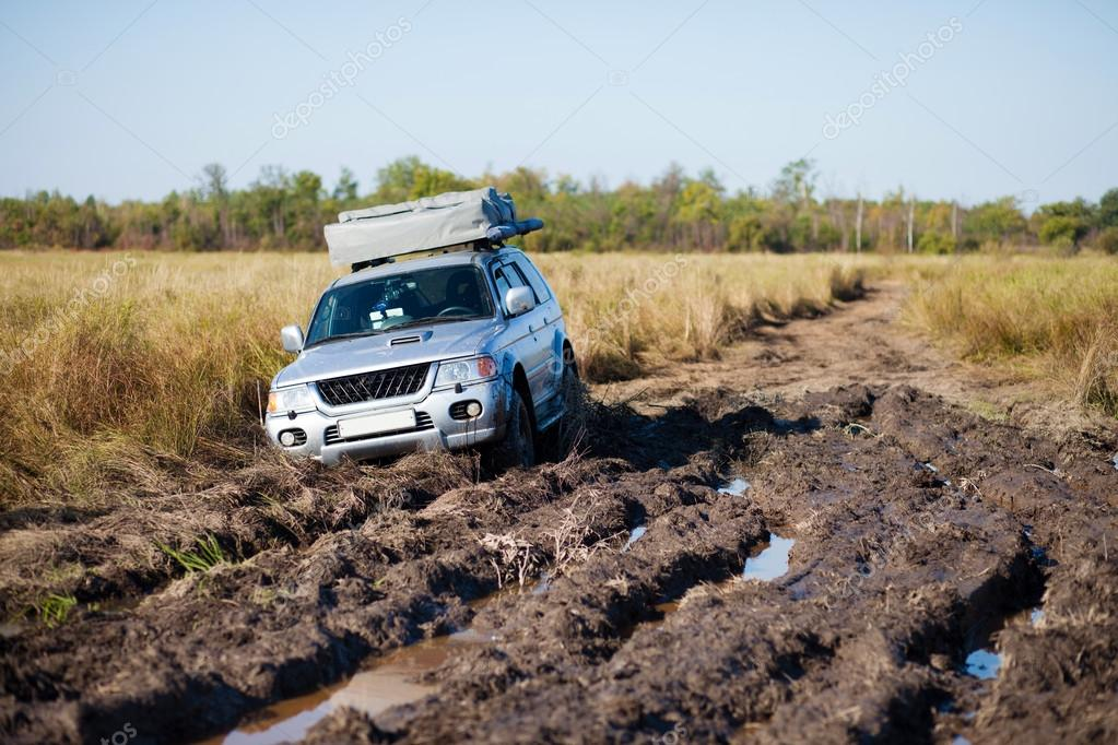 4x4 car stuck in mud