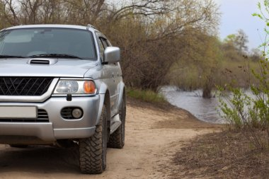 4x4 SUV on a road near a river