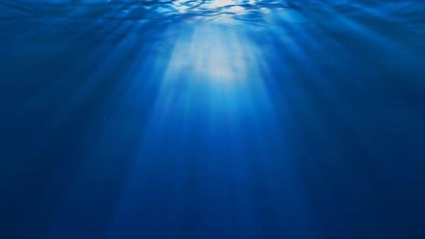 víz alatti jelenetet sunrays besütött a víz felszínén