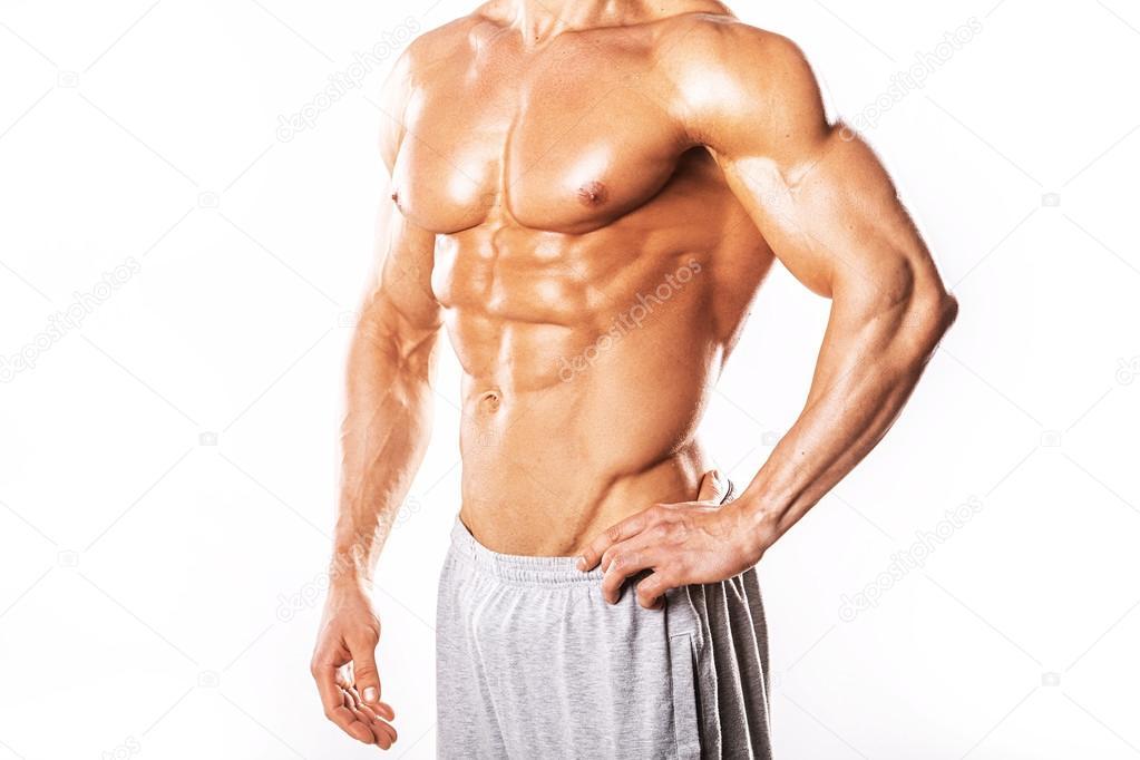 Starker sportlicher Mann, muskulösen Körper und Sixpack Bauchmuskeln ...