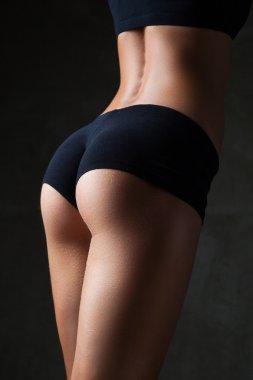 Beautiful fit, sexy female body on dark grey