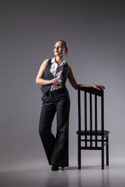 Mafiosi woman with brandy. Fashion photo