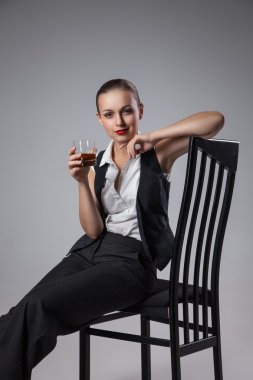 Mafiosi woman with brandy. Fashion photo