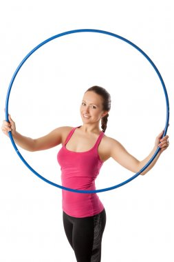 Young woman standing with hula hoop up and front