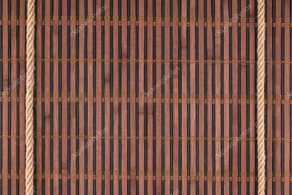 Dos cuerdas acostado sobre una estera de bambú — Fotos de Stock ...