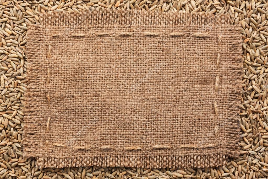 Marco de arpillera sobre un fondo de centeno — Foto de stock ...