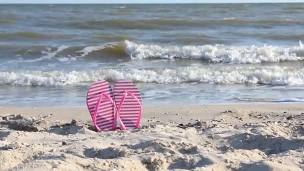 Flip flops on the beach at sunset