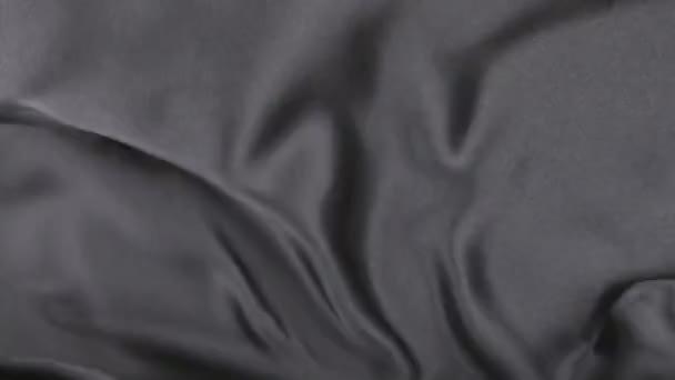wellenförmige Bewegung schwarzer Stoff, Draufsicht