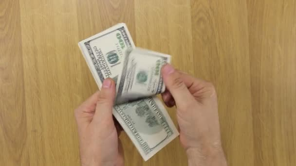Counting dollars over the desk