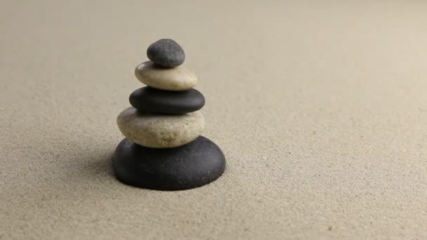Stones pyramid on sand symbolizing zen.
